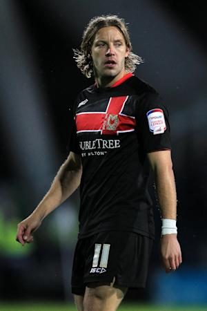 Karl Robinson feels Alan Smith, pictured, needs more protection from referees