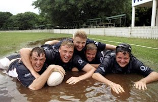 Feb 1999: Graeme Swann, Andrew Flintoff, Darren Maddy, Matt Windows and Robert Keys of the England A squad dive into a puddle during the England A tour of Zimbabwe in Harare, Zimbabwe.