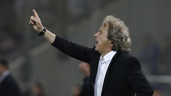 Benfica's coach Jorge Jesus gives instructions to his players during a Champions League group C soccer match between Olympiakos and Benfica at Karaiskaki stadium, in Piraeus, near Athens, Tuesday, Nov. 5, 2013