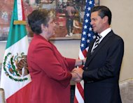 Mexican President Enrique Pena Nieto at a meeting with US Homeland Security Secretary Janet Napolitano on July 24, 2013. It is the second major success in the fight against the cartels for Nieto, following the arrest last month of the head of the Zetas cartel