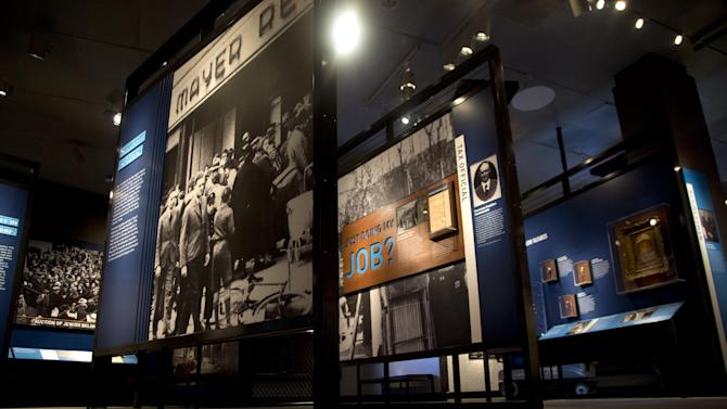 """This Thursday, April 25, 2013 photo shows a preview of the new exhibit at the United States Holocaust Memorial Museum, titled """"Some Were Neighbors: Collaboration & Complicity in the Holocaust"""" in Washington. The exhibition, opening April 30, 2013, includes interviews with perpetrators of collaboration and complicity in the Nazi genocide. (AP Photo/Carolyn Kaster)"""