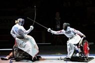 Hungary's Zsuzsanna Krajnyak (L) compets against China's Wu Bai Li during the final of the Wheelchair Women's Epee at the 2011 World Fencing Championships. China's wheelchair fencers will be aiming to better their four-medal tally from 2008 with a team that includes three World Champions, and the country also boasts powerful swimming and archery teams