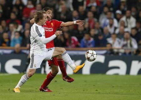 Real Madrid's Luka Modric  challenges Liverpool's Lazar Markovic during their Champions League Group B soccer match at Santiago Bernabeu stadium in Madrid