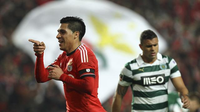 European Football - Benfica outplay Sporting in delayed derby to stretch lead