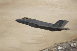 File photo of the second production model F-35A Lightning II aircraft flies above the compass rose of Rogers Dry Lakebed at Edwards Air Force Base
