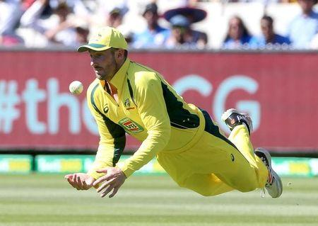 Australia's Shaun Marsh dives to collect a skied shot from India's Virat Kohli on the first bounce during their One Day cricket match at the Melbourne Cricket Ground