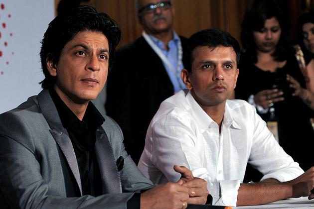 Indian Bollywood film actor Shah Rukh Khan (L) and former Indian cricketer Rahul Dravid attend a press conference on the occasion of the Toyota University Cricket Championship (TUCC) first match of th