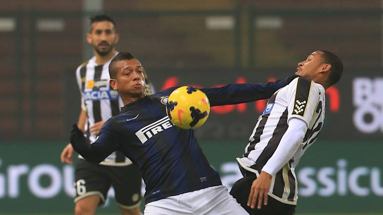Inter Milan's Fredy Guarin, left, and Udinese's Antunes Da Silva vie for the ball during an Italian Cup soccer match, between Udinese and Inter at the Friuli Stadium in Udine, Italy, Thursday, Jan. 9, 2014
