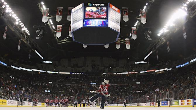 Oshawa Generals goalie Ken Appleby celebrates his team's overtime victory against the Quebec Remparts during their Memorial Cup ice hockey game at the Colisee Pepsi in Quebec City