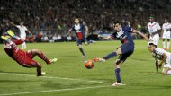 Paris St Germain Javier Pastore (R) tries to shoot a goal past Olympique Lyon's goalkeeper Anthony Lopes during their French Ligue 1 soccer match at the Gerland stadium in Lyon April 13, 2014. REUTERS/Robert Pratta (FRANCE - Tags: SPORT SOCCER)
