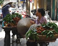 Fruit vendors are seen on a street in Hanoi, in June. Vietnamese inflation has slowed to the weakest pace in more than two years, the government said on Tuesday, mirroring cooling economic growth in the communist state