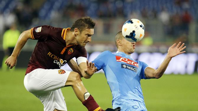 AS Roma's Francesco Totti, left, and Napoli's Gokhan Inler of Switzerland compete for the ball during a Serie A soccer match between AS Roma and Napoli at Rome's Olympic stadium, Friday, Oct. 18, 2013