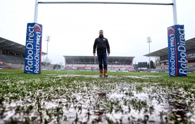 General view of the waterlogged pitch that caused the game to be called off