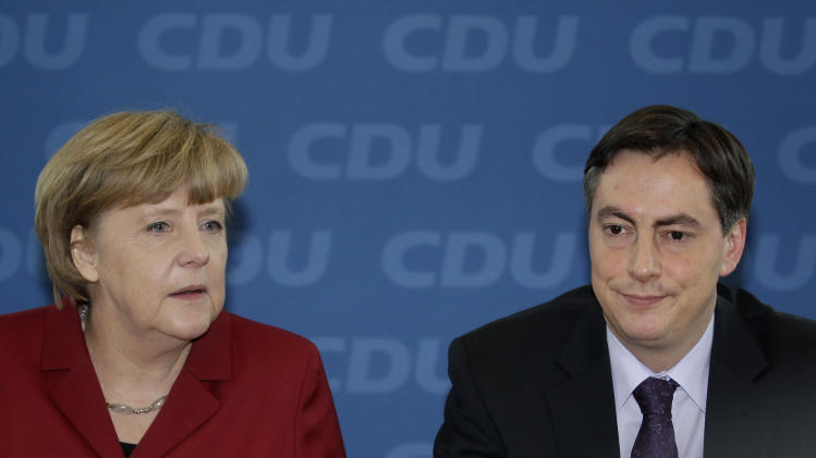 German Chancellor and chairwoman of the German Christian Democrats, CDU, Angela Merkel, left, and the CDU top candidate of the Lower Saxony state elections, David McAllister, right, attend the party's weekly executive committee meeting in Berlin, Germany, Monday, Jan. 21, 2013.  A defeat for Chancellor Angela Merkel's coalition in a high-profile state election is a blow to the German leader as she seeks a third term later this year — but it's far from clear whether the opposition will be strong enough to oust the popular conservative.  (AP Photo/Michael Sohn)