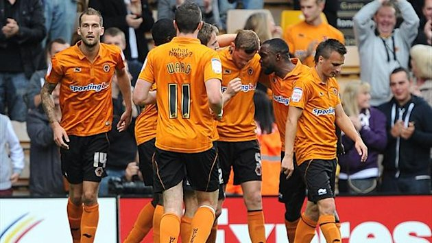 Wolverhampton Wanderers's Richard Stearman (third right) celebrates scoring his side's second goal of the game with team-mates (PA Photos)