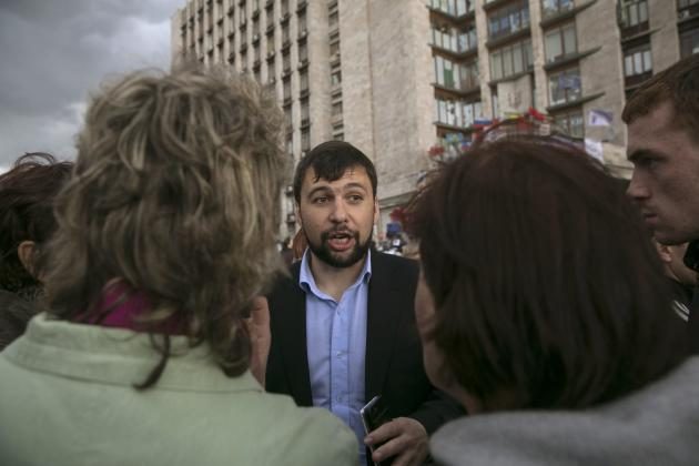 Head of the pro-Russian separatists government Denis Pushilin speaks to people outside a regional government building in Donetsk, eastern
