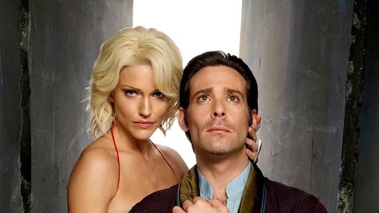 James Callis as Dr. Gaius Baltar and Tricia Helfer as Number Six in Battlestar Galactica on the Sci Fi Channel.
