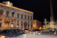 Prime Minister Mario Monti leaves the presidential palace in Rome late Friday after resigning. Italy's election campaign kicked off on Saturday amid uncertainty over whether Monti will launch himself into the political fray and fight billionaire Silvio Berlusconi for the top job.