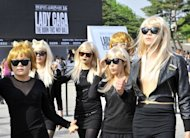 South Korean fans dressed as Lady Gaga get ready for the start of the pop star's global tour at Seoul's Olympic Stadium. Tens of thousands of South Koreans flocked to the opening show of the tour amid colourful scenes as female and male fans donned outrageous outfits in honour of the US pop diva