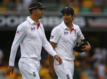 England's captain Cook talks with teammate Pietersen as they walks off the field at the end of the second day's play of the first Ashes cricket test match against Australia, in Brisbane