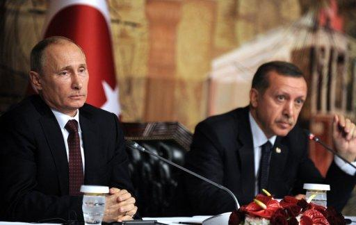 Turkish Prime Minister Recep Tayyip Erdogan (R) and Russian President Viladimir Putin give a press conference on December 3, in Istanbul. NATO foreign ministers are expected Tuesday to approve Turkey's request for deployment of Patriot missiles to counter a threat from Syria as Washington bluntly warned Damascus against the possible use of chemical weapons