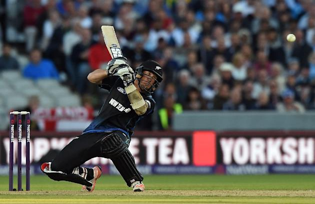 New Zealand's Luke Ronchi hits the ball to be caught out by England's Jonny Bairstow during the Twenty20 international match at Old Trafford on June 23, 2015