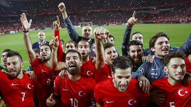 Turkey's players celebrate after winning their Euro 2016 Group A qualification soccer match against Iceland in Konya