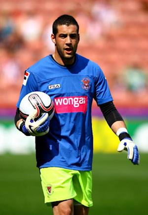 Goalkeeper Dean Bouzanis was sent off for Oldham following a late altercation