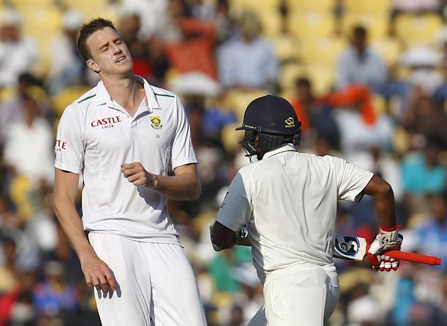 South Africa's Morkel reacts as India's Mishra runs between wickets during the second day of their third test cricket match in Nagpur