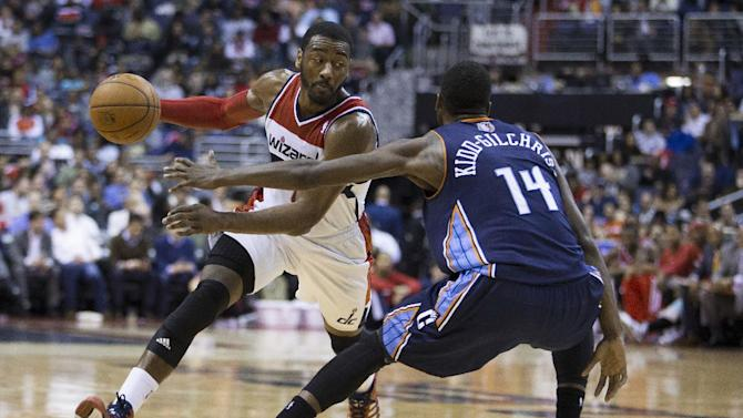 Charlotte Bobcats forward Michael Kidd-Gilchrist (14) defends Washington Wizards guard John Wall during the second half of an NBA basketball game Wednesday, March 12, 2014, in Washington. The Bobcats defeated the Wizards 98-85