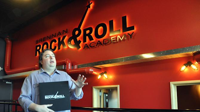 Chuck Brennan, founder of Dollar Loan Center, talks about the rehearsal rooms inside the Brennan Rock & Roll Academy, which will give Boys & Girls Clubs members a chance to learn vocals, guitar, bass, keyboard and drums, Thursday, March 21, 2013 in Sioux Falls, S.D. A week of grand opening events will include performances by Alice Cooper, Robby Krieger of The Doors and Night Ranger. (AP Photo/Dirk Lammers)