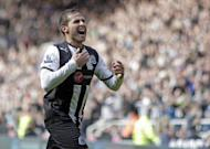 Newcastle United's midfielder Yohan Cabaye celebrates scoring his second goal during their English Premier League football match against Stoke City at Sports Direct Arena in Newcastle. Newcastle won 3-0