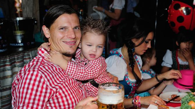 Daniel van Buyten of Bayern Munich from Belgium attends the Oktoberfest beer festival in Munich southern Germany, Sunday, Oct 6, 2013