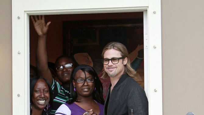 Brad Pitt visits a family staying in a house rebuilt by his