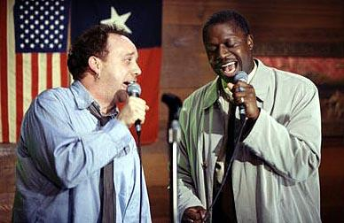 Escaping his mind-numbing existence on the hamster-wheel of life, Todd Woods ( Paul Giamatti , left) discovers the joys of karaoke singing and finds a new friend in ex-con and soulful singer Reggie Kane ( Andre Braugher , right) in Hollywood Pictures' Duets
