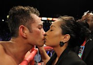 CARSON, CA - OCTOBER 13: Nonito Donaire of The Phillipines gets a kiss from wife Rachel Marcial after his ninth round TKO of Toshioka Nishioka of Japan during the WBO Super Bantamweight Title fight at The Home Depot Center on October 13, 2012 in Carson, California. (Photo by Harry How/Getty Images)