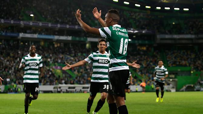 Sporting's Andre Carrillo, from Peru, canter, celebrates after scoring their second goal against Setubal  during their Portuguese league soccer match Saturday, Oct. 5 2013, at Sporting's Alvalade stadium in Lisbon