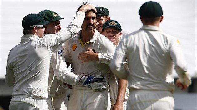 Mitchell Johnson and Australia celebrate