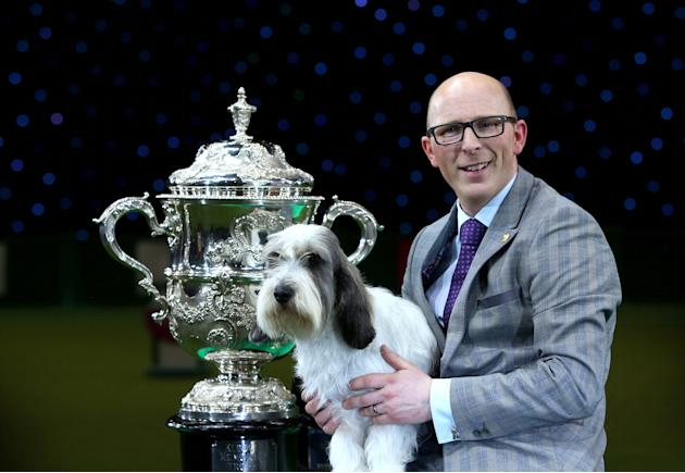 Gavin Robertson with Jilly, a Basset Griffon Vendeen, as they celebrate winning the Best in Show (Photo by Rosie Hallam/Getty Images)