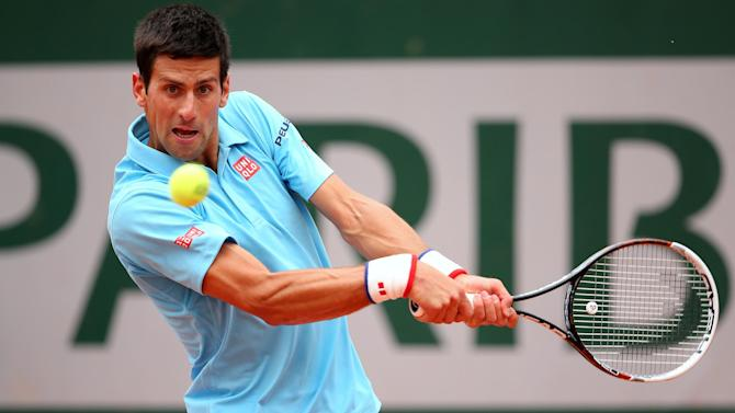 French Open - Djokovic hammers Tsonga to make Roland Garros quarters