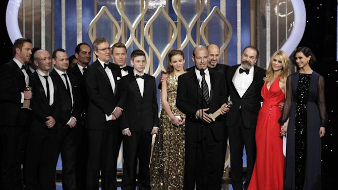 """This image released by NBC shows Executive Producer Howard Gordon, foreground, accepting the award for best TV drama series for """"Homeland"""" during the 70th Annual Golden Globe Awards at the Beverly Hilton Hotel on Jan. 13, 2013, in Beverly Hills, Calif. (AP Photo/NBC, Paul Drinkwater)"""