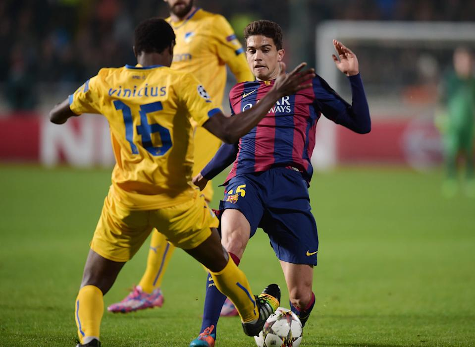 Barcelona's Barta is challenged by APOEL Nicosia's Vinicius during their Champions League soccer match in Nicosia