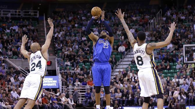 Dallas Mavericks' Vince Carter (25) shoots as Utah Jazz's Richard Jefferson (24) and Diante Garrett (8) defend in the second quarter during an NBA basketball game Wednesday, March 12, 2014, in Salt Lake City