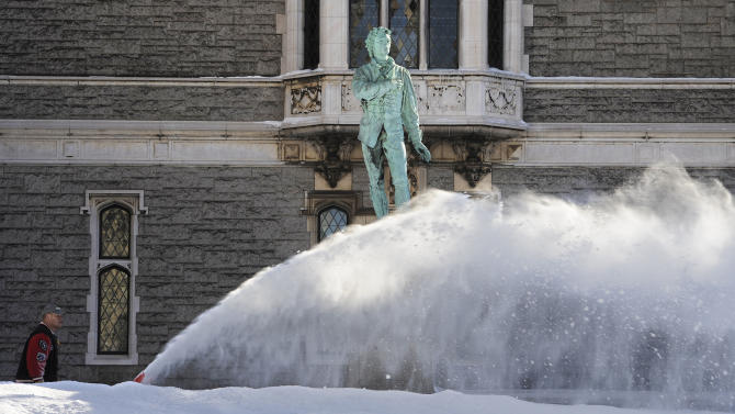 A man uses a snowblower around a statue of Nathan Hale outside the Wadsworth Atheneum after a winter storm in Hartford, Conn., Sunday, Feb. 10, 2013. A howling storm across the Northeast left much of the New York-to-Boston corridor covered with more than three feet of snow on Friday into Saturday morning. (AP Photo/Jessica Hill)