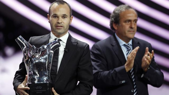 Iniesta edges Messi, Ronaldo to UEFA award