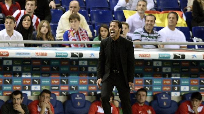 Atletico Madrid's coach Diego Simeone, from Argentina, yells during his team's Spanish La Liga soccer match against Espanyol at Cornella-El Prat stadium in Cornella Llobregat, Spain, Saturday, Oct. 19, 2013