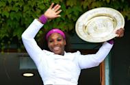 Serena Williams celebrates with her women's singles trophy, the Venus Rosewater Dish, on the clubhouse balcony after the final victory over Poland's Agnieszka Radwanska on Day 12 of the 2012 Wimbledon Championships at the All England Tennis Club in Wimbledon, southwest London, on July 7. Williams won 6-1, 5-7, 6-2