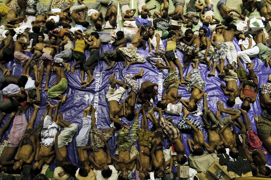 Migrants believed to be Rohingya rest inside a shelter after being rescued from boats at Lhoksukon in Indonesia's Aceh Province