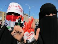 "Two women hold up their hands painted with the Arabic writing: ""from one victory to another"" during a protest in Sanaa on January 27, 2012, to demand the arrest and trial of Yemen's veteran President Ali Abdullah Saleh"