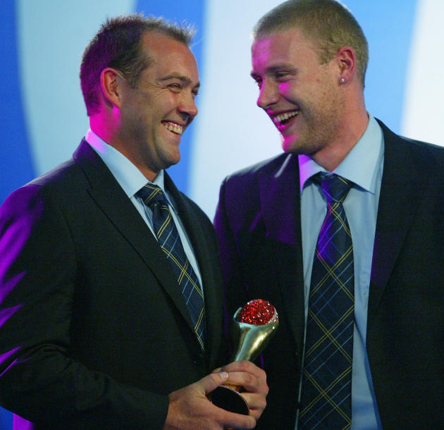 SYDNEY, AUSTRALIA - OCTOBER 11:  Jacques Kallis and Andrew Flintoff share a joke after receiving a joint Sir Garfield Sobers Trophy for the Players of the Year award during the ICC Awards Ceremony at